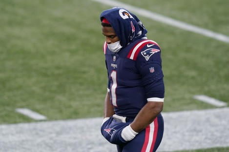 New England Patriots quarterback Cam Newton on the sideline during their defeat to the Buffalo Bills.