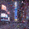 Crowds gather in New Zealand and China for New Year celebrations - but a muted tone is struck elsewhere