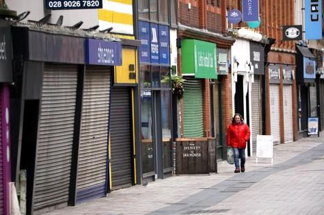 A man walks through a deserted Belfast city centre