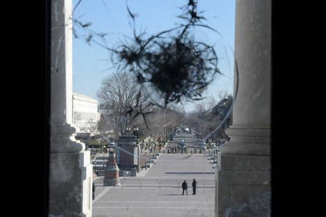 A Congress windows a day after pro Trump rioters stormed Capitol Hill last week.