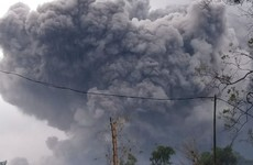 Highest volcano on Indonesia's Java island spews hot clouds