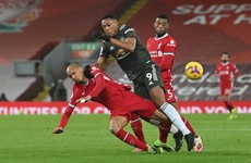 Man United hold Liverpool to maintain top spot