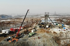 At least 15 days before trapped mine workers in China will be reached, authorities say