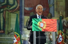 Portugal reelects TV pundit as president, after people brave the pandemic to vote