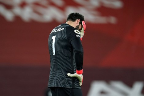 Liverpool goalkeeper Alisson reacts after the third Man City goal.