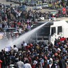 Police fire rubber bullets at anti-coup demonstrators as crowds continue to defy military