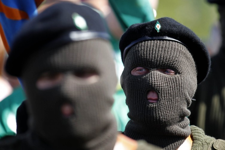Members of the Real IRA attend an Easter Rising anniversary event last year. The Real IRA is one of three groups which have merged to reclaim the title of the 'Irish Republican Army'.