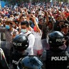 Tensions mount in Myanmar as protesters step in to prevent arrest of anti-coup activists