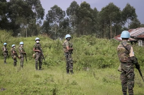 United Nations peacekeepers guard the area where a convoy was attacked