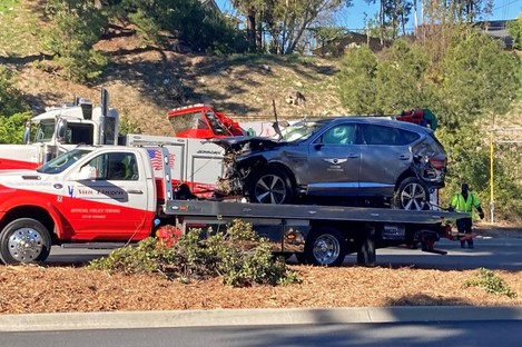 The vehicle driven by Tiger Woods was removed from the scene on Tuesday.