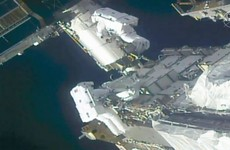 Spacewalking astronauts prepare station for new solar wings