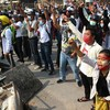Eighteen people dead and journalist in police custody after Myanmar protests