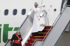 Pope Francis arrives in Iraq for first papal visit amid pandemic and security concerns