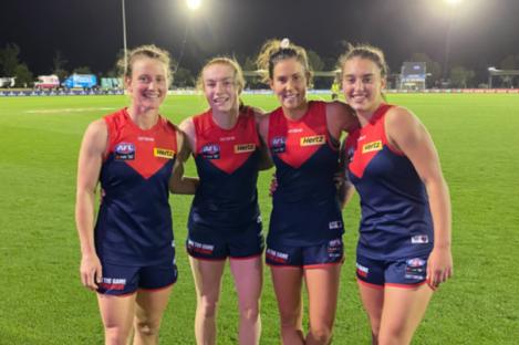 Lauren Magee (second left) celebrates with her Melbourne team-mates.