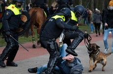 Dutch police break up anti-government protest on eve of election