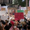 Australians rally for justice for women as alleged rapes shake government