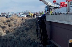 Rescuers save two people out of truck dangling from bridge over 100ft deep gorge in Idaho