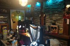 Gardaí seize beer kegs and bar equipment during search of suspected shebeen in Monkstown