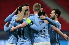Man City stroll into Champions League last 8