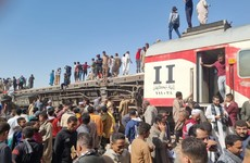 Two trains collide in southern Egypt, killing at least 32 and injuring dozens