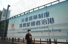 China sharply reduces elected seats in Hong Kong legislature during radical overhaul