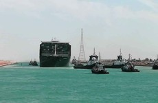 Ships sail through Suez Canal again after large shipping container freed