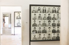 Irish artist criticised in Cambodia for adding smiles to colourised images of genocide victims