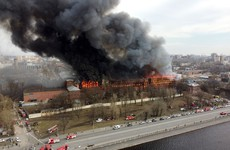 Firefighter killed and two others injured as fire engulfs business centre in St Petersburg
