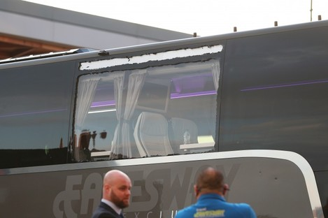A photo showing the damage to a window on the Real Madrid team bus.