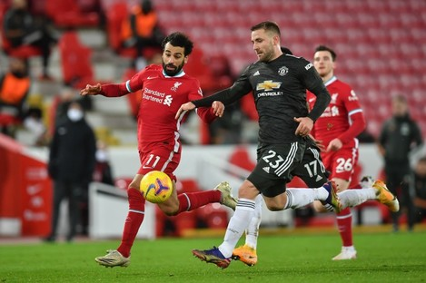 Mohamed Salah tangling with Luke Shaw during last January's Premier League meeting of Liverpool and Manchester United.