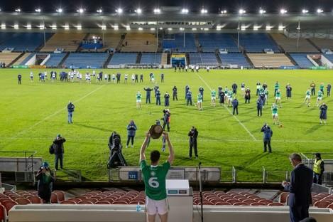 Declan Hannon raises the Munster senior hurling cup.