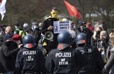 Police clash with protesters as Germany passes law to impose 10pm curfews