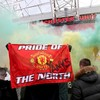 Manchester United-Liverpool postponed after fans storm Old Trafford pitch