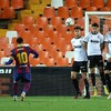 Messi nets a double at Valencia to rescue Barcelona's title hopes