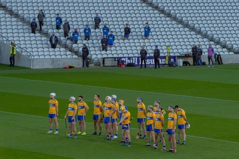 Clare players and substitutes in the stand.