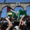 Dozens hurt as Palestinians and Israeli police clash at Al-Aqsa Mosque