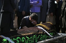 Afghans bury dead from bloody school blasts