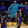 Last-gasp Lakers keep Knicks waiting for NBA playoff spot