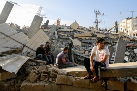 Palestinians following an air strike in the northern Gaza Strip on Thursday.