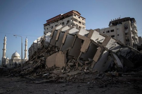 The remains of a building destroyed by Israeli air strikes on Gaza City