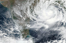 Cyclone makes landfall as India continues to deal with its Covid surge