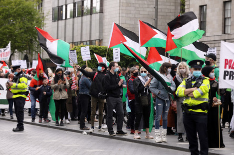 Gardai watch huge crowds of people protesting in Dublin in solidarity with the Palestinian people. 22 May 2021.