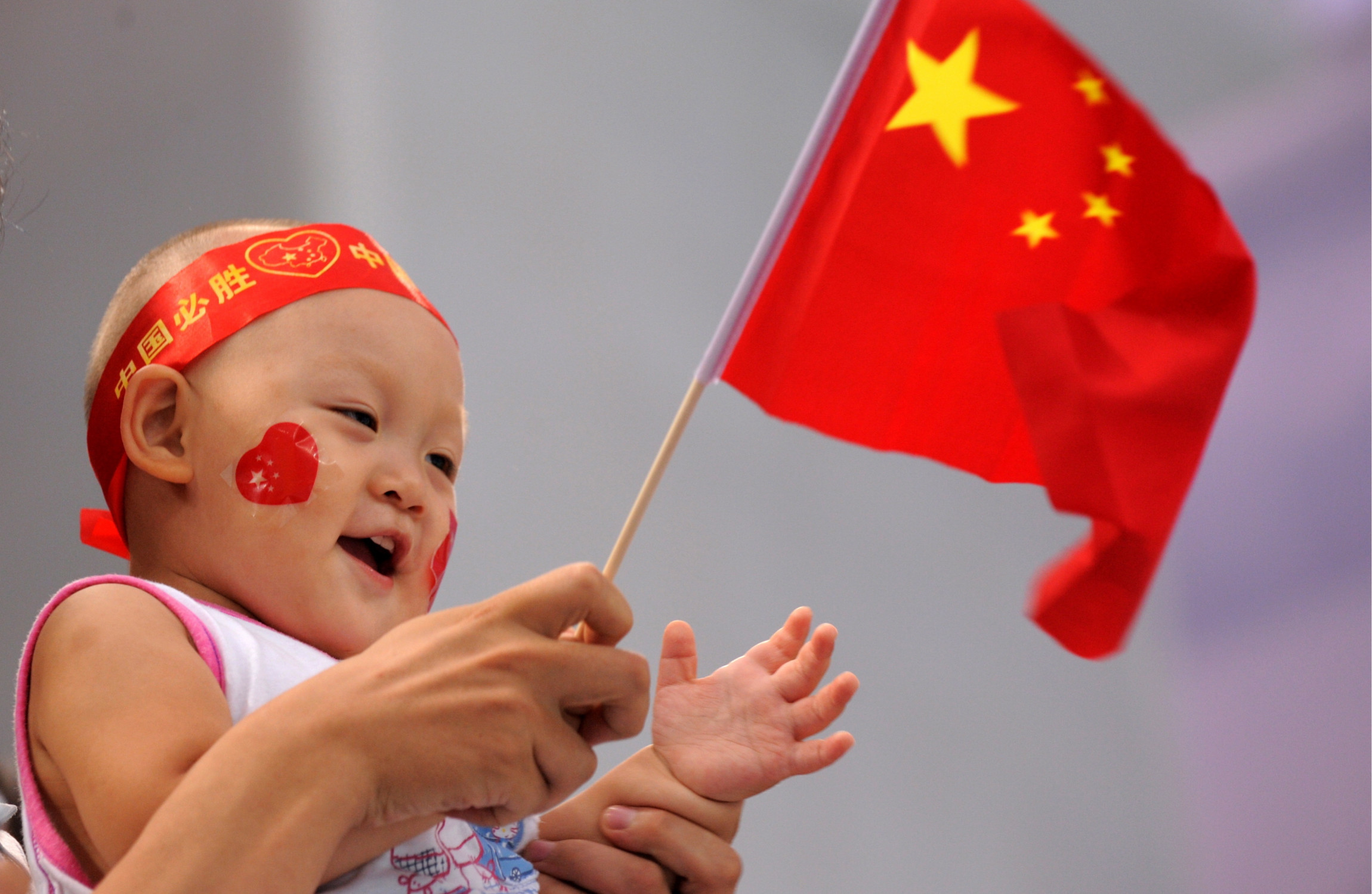 China allows couples to have three children