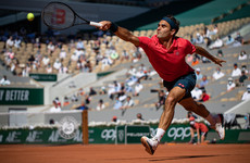 Federer impresses with straight-sets win on grand slam return at French Open