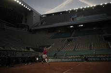 Djokovic eases to opening Roland Garros win on silent night