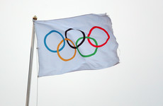 Olympics '100%' going ahead but major Covid outbreak could shut door on fans