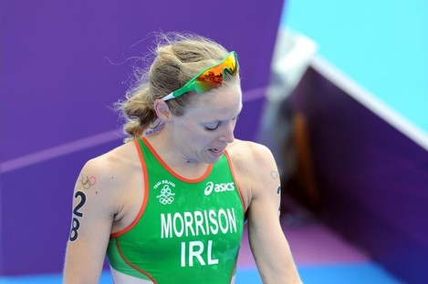 Morrison assesses her injuries as she crosses the finish line.