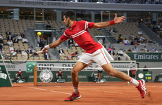 Djokovic sets up Nadal reunion after curfew-interrupted French Open quarter-final