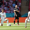 Section of England fans defy pleas not to boo players taking the knee