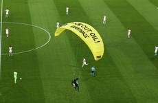 Activist lands on pitch before Germany-France match, 'injures several fans'